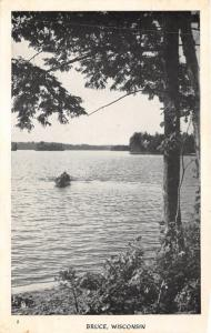 Bruce Wisconsin~People in Boat Approaching Shore~1920s North Woods Postal Pc