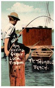 Connecticut Fort Trumbull beach, boy fishing on dock