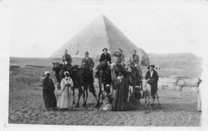Tourists and their Guides at the Pyramids, Egypt, early real photo postcard