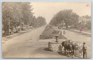 Tomah WI~Horse Team Drink From Trough Fountain~Gardner on Median~Homes~1911 RPPC