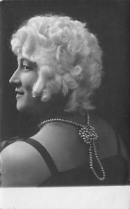 Black and White picture of a woman with white hair Writing on Back