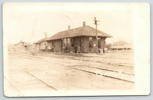 Elmore Minnesota~Railroad Depot~Men Waiting on Platform~Stables~1914 RPPC
