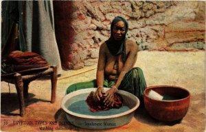 PC CPA Sudanese woman washing clothes EGYPT FEMALE ETHNIC NUDE (a11179)