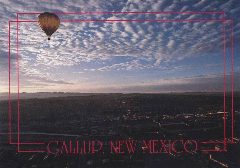 A hot air balloon floats peacefully over Gallup, New Mexico, 40-60s