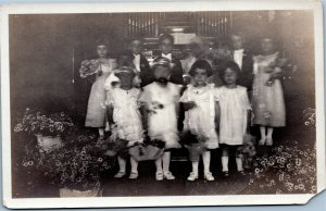 postcard rppc - Flower girls and ring bearers in front of organ at wedding AZO