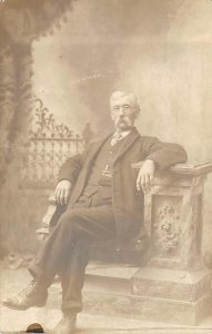 Man Sitting in a Chair Real Photo Unused