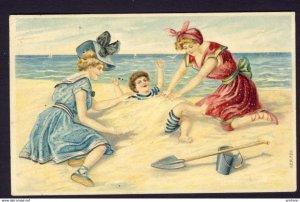 Ladies swimsuit boy sand pail shovel beach white caps ocean embossed