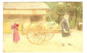 RP: Man pulling cart, Young woman & child follow, Japan, 00-10s