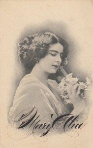 Female holding flowers portrait , 1913 ; Mary Alice