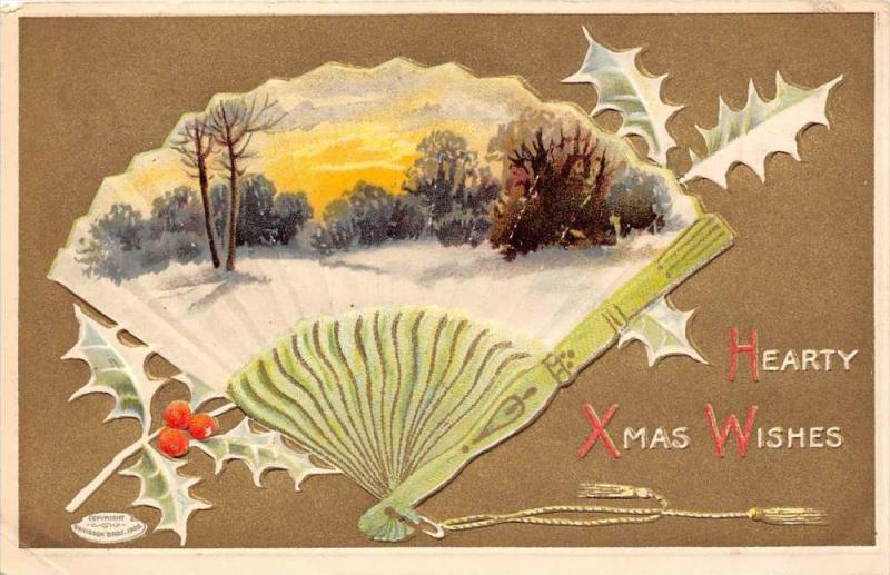 Hand Fan with snow scene on it, holly