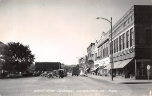 Chariton IA Montgomery Ward~Liggit's Drugs~Gambles~Jeweler Howe RPPC c1941 Cars