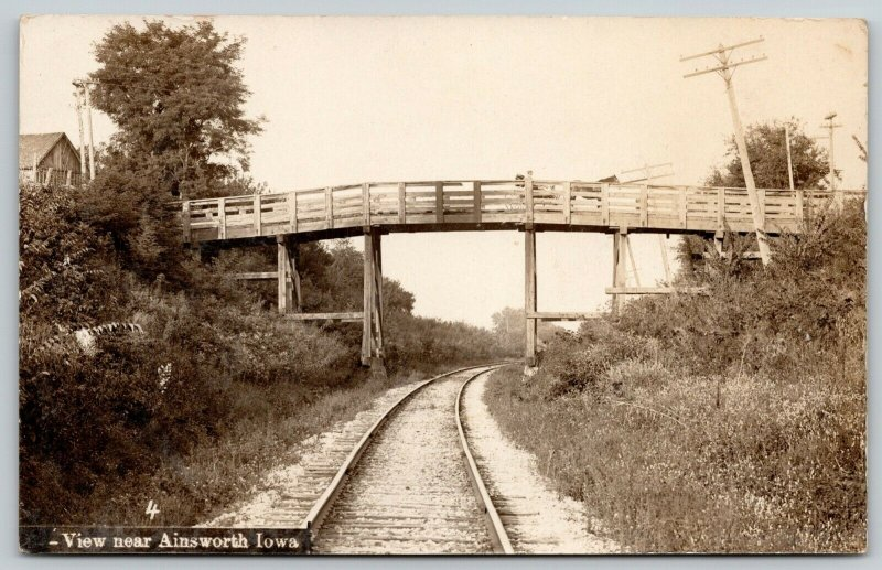 Ainsworth Iowa~Railroad Tracks Under Wooden Truss Bridge~Horse Buggy~c1908 RPPC