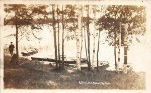 F52/ Rose City Michigan RPPC Postcard c1940s Rifle Lake Boat Man Shore