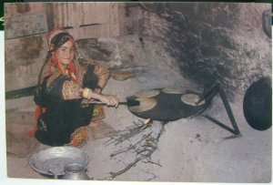 Pakistan Kalash Woman making Bread in Chitral - unposted