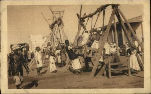 From Djibouti Group  Natives Children Swings c1915 Postcard