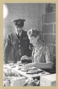 Nostalgia Reprint: Aircraft Factory 1942 pilot watches woman works on aircraft