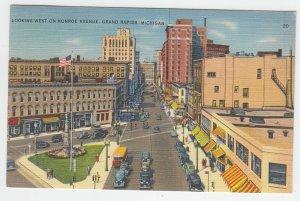 P2060 1938 postcard birds eye view traffic stores monroe ave grand rapids mich
