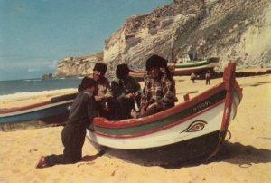 NAZARE , Portugal, 1960-80s ; Fishermen in boat