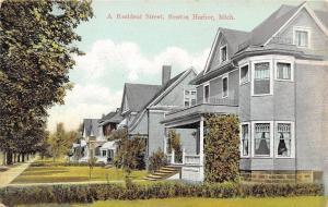 Benton Harbor Michigan~A Resident Street~Long Row of Houses~Sidewalk~1910 PC