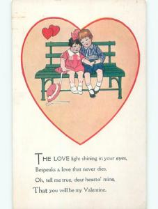 Pre-Linen valentine GIRL TAKES OFF HAT AND SITS ON BENCH WITH BOY J0145