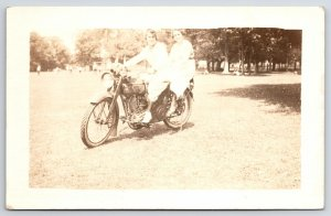 2 Ladies in White w/Short Hair on Harley Davidson Motorcycle RPPC c1921