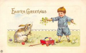 Easter~Lil Boy Entices White Rabbit With Greens~Eggs Fill Red Wagon~Emboss~309 F