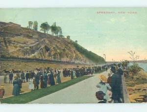 Divided-Back PEOPLE LINING THE SPEEDWAY TO WATCH HORSES GO BY New York NY i1631