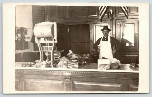 Central City Iowa~Meat Market~Butcher at Counter~2 Wall Telephones~1910 RPPC