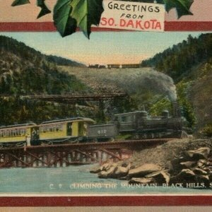 Train Black Hills South Dakota Voedisch's Jeweler Christmas New Years Postcard