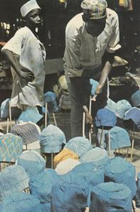African Hat Maker in Nigeria Market Postcard
