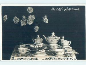 1942 rppc ANTIQUE TEAPOT AND TEA CUPS ON THE TABLE HM0837