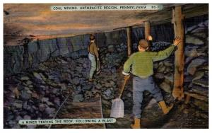 Pennsylvania , Coal Mining , Miner testing the Roof following a blast