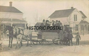 LARGE GROUP OF PEOPLE IN WOOD SLEIGH PULLED BY TEAM HORSES~REAL PHOTO POSTCARD