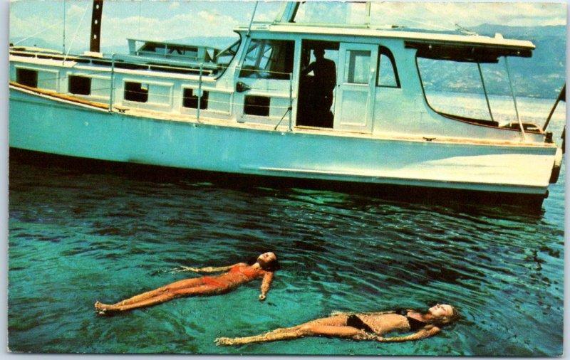 1960s Sand Cay, Haiti Postcard Wish You Were Here! Girls in Bikinis / Boat
