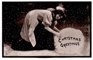 Christmas  ,  Woman, Giant snowball , Tuck's No. 362 Real Photograph