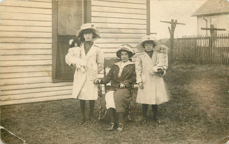 Mother And Daughters Pose Outside~Easter Bonnets~Rocking Chair~Dolls~1918 RPPC