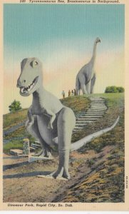 RAPID CITY, South Dakota, 1930-40s; Tyrannosaurus Rex, Brontosaurus in Backgr...