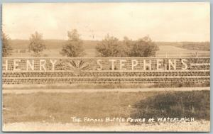 FAMOUS BOTTLE FENCE at WATERS MI 1925 ANTIQUE REAL PHOTO POSTCARD RPPC