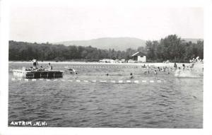 Antrim New Hampshire scenic view bathers in lake real photo pc Z41579