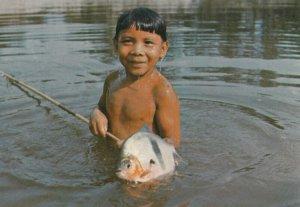 BRASIL NATIVO , 1960-80s ; laualapita boy , Tuatuari River, with Pacu fish ...