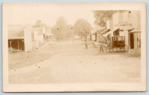 Real Photo Postcard~Livery Stable~Boys in Dirt Road by Wagon Coach~1907 RPPC