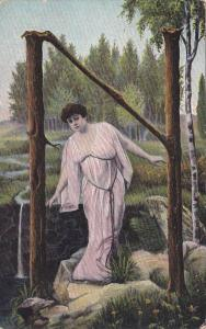 Large Letter N, Startled woman wearing pink frock in the forest, 00-10s