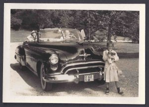 PICTURE OF OLDSMOBILE CONVERTIBLE AFTER WW2