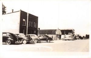 Thompsonville MI~1940s Cars Parked in Front of Shops~Service Station~RPPC 1952