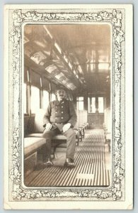 Wilmantic CT~Train Conductor in Passenger Car~Recognize Me~1912 Art Nouveau RPPC