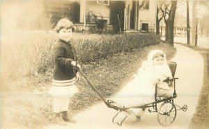Boy Girl in full Cart C-1910 RPPC Photo Postcard 20-6897