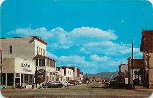 Saratoga WY~Bridge Street~East~Donelan Pharmacy~Sisson Hotel~Nice 1950s Cars