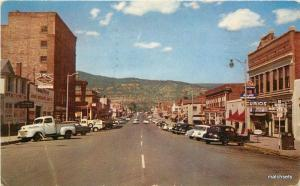 1958 RATON NEW MEXICO Business Section automobiles Noble postcard 742