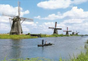 Couple Canoeing in Kinderdijk, Village with 19 Windmills, Holland