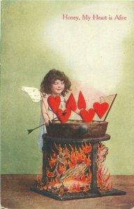Honey My Heart is Afire Girl Cherub Roasting Hearts Over Fire 1908 Postcard